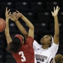 Alabama guard Jasmine Robinson (3) has her shot blocked by Mississippi State forward Sherise Williams (5) during the first half of their NCAA college basketball game in the Southeastern Conference tournament, Wednesday, March 6, 2013, in Duluth, Ga. (AP Photo/John Bazemore)