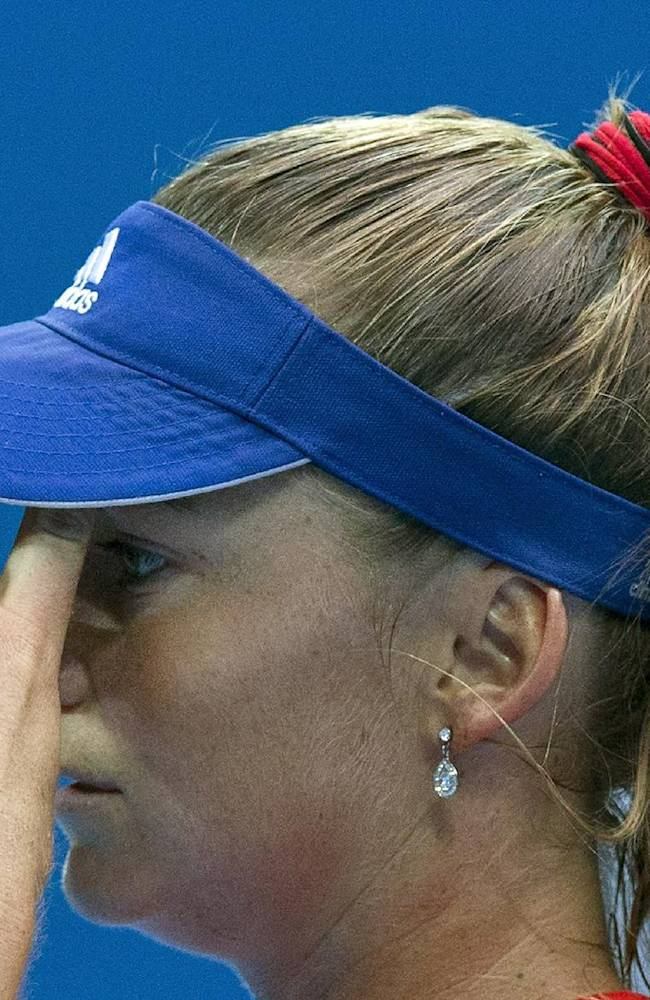 Daniela Hantuchova of Slovakia wipes her sweat as she prepares to serve against Li Na of China during their first round of the China Open tennis tournament at the National Tennis Stadium in Beijing, China Sunday, Sept. 29, 2013