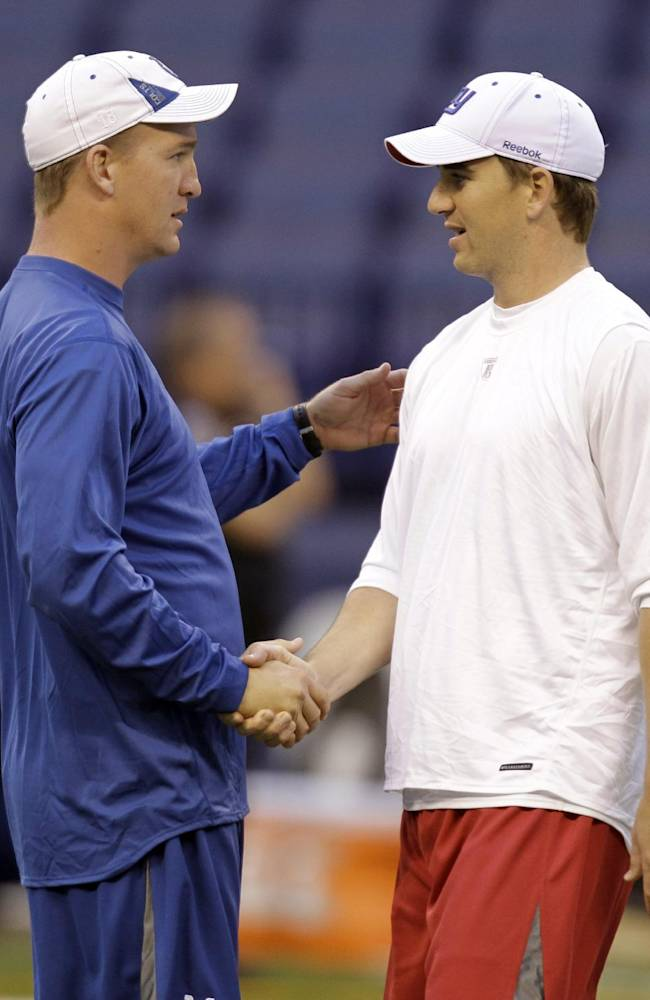 In this Sept. 19, 2010 file photo, Indianapolis Colts quarterback Peyton Manning, left, and his brother,  New York Giants quarterback Eli Manning shake hands during warm ups before the start of an NFL football game in Indianapolis. Peyton loves Eli's game, and not just because he's his little brother