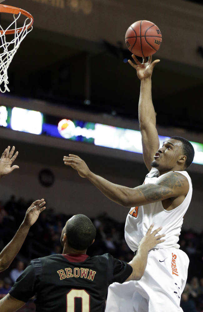 Pacific's Khalil Kelley shoots over Santa Clara's Jerry Brown during the first half of a West Coast Conference tournament NCAA college basketball game on Thursday, March 6, 2014, in Las Vegas. Santa Clara defeated Pacific 81-64