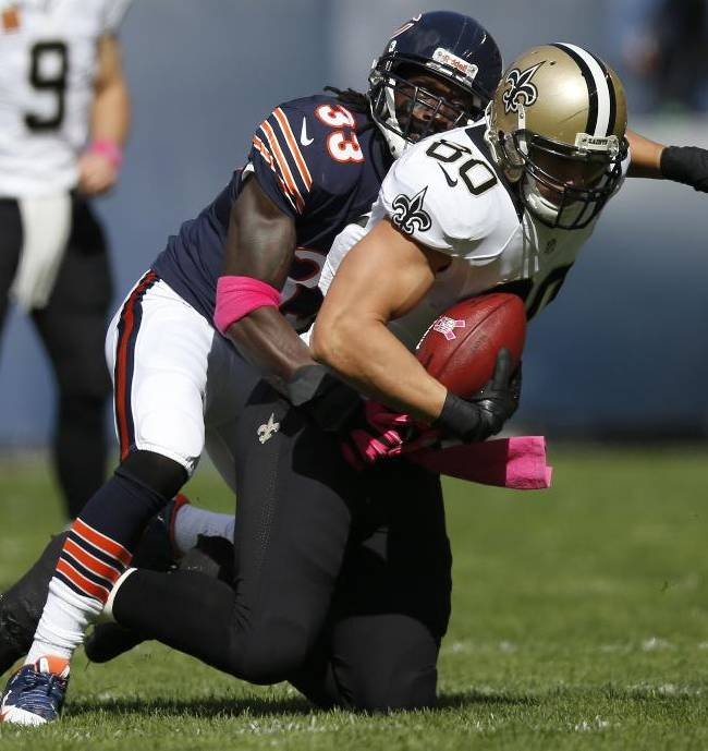 Chicago Bears cornerback Charles Tillman (33) tackles New Orleans Saints tight end Jimmy Graham (80) during the first half of an NFL football game, Sunday, Oct. 6, 2013, in Chicago