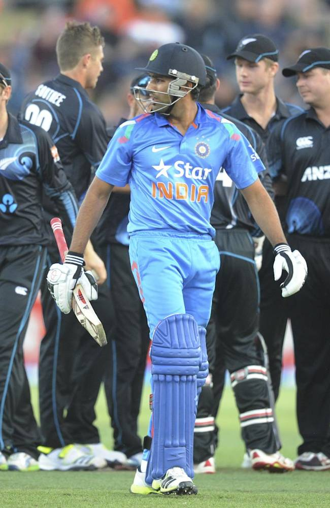 India's Rohit Sharma looks back after being dismissed by New Zealand's Tim Southee for 20 in the second one day International cricket match at Seddon Park in Hamilton, New Zealand, Wednesday, Jan. 22, 2014