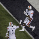 Auburn wide receiver Ricardo Louis (5) and wide receiver D'haquille Williams (1) celebrate after Louis scored a touchdown during the first half of an NCAA college football game against Kansas State Thursday, Sept. 18, 2014, in Manhattan, Kan. (AP Photo/Charlie Riedel)