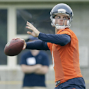 Chicago Bears quarterback Jimmy Clausen (8) looks to pass during team's NFL football training camp at Olivet Nazarene University on Saturday, July 26, 2014, in Bourbonnais, Ill The Associated Press