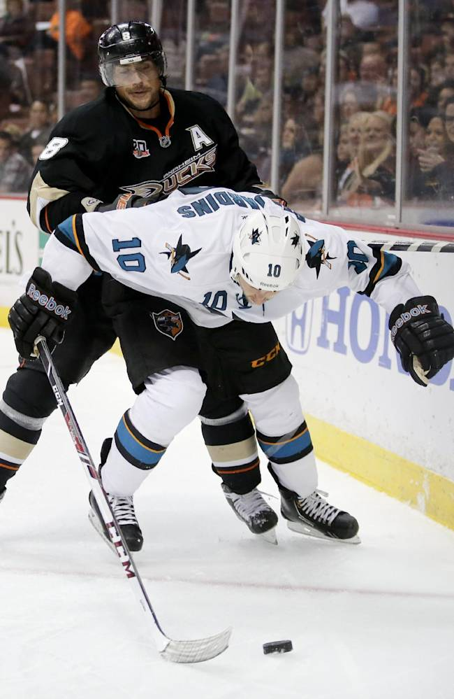 Anaheim Ducks right wing Teemu Selanne, left, battles San Jose Sharks center Andrew Desjardins for the puck during the third period of an NHL hockey preseason game in Anaheim, Calif., Saturday, Sept. 28, 2013