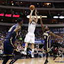 CORRECTS SHOOTER TO JOSE CALDERON- Dallas guard Jose Calderon (8) shoots the ball over Indiana Pacers' Roy Hibbert (55) and Donald Sloan (15) during the first half of an NBA game, Sunday, March 9, 2014, in Dallas, Texas The Associated Press
