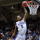Duke's Rodney Hood dunks over UNC-Asheville's Sam Hughes, left, and Jaleel Roberts, back center, during the first half of an NCAA college basketball game in Durham, N.C., Monday Nov. 18, 2013. (AP Photo/Ted Richardson)