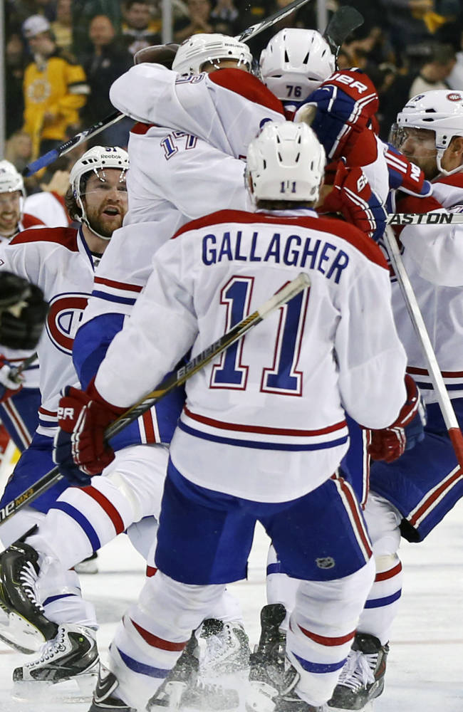 Montreal Canadiens teammates celebrate with P.K. Subban (76) after his game-winning goal in the second overtime period against the Boston Bruins in Game 1 of an NHL hockey second-round playoff series in Boston, Thursday, May 1, 2014. The Canadiens won 4-3