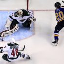 Minnesota Wild goalie Devan Dubnyk, top left, makes a save on a shot by St. Louis Blues' Alexander Steen, right, as Wild's Jared Spurgeon, bottom, watches during the second period in Game 5 of an NHL hockey first-round playoff series, Friday, April 24, 2015, in St. Louis. (AP Photo/Jeff Roberson)