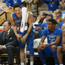 Kentucky's Devin Booker, second from left, laughs as he stands near teammates Aaron Harrison, right, and Marcus Lee in the closing minute of an NCAA college basketball game against Missouri on Thursday, Jan. 29, 2015, in Columbia, Mo. Kentucky won 69-53. (AP Photo/L.G. Patterson)