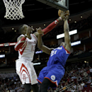 Philadelphia 76ers' Thaddeus Young (21) has his shot blocked by Houston Rockets' Dwight Howard (12) during the first half of an NBA basketball game on Thursday, March 27, 2014, in Houston The Associated Press