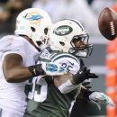 Miami Dolphins outside linebacker Jelani Jenkins (53) disrupts a pass to New York Jets tight end Jeff Cumberland (85) to cause an interception with seconds left in the fourth quarter an NFL football game, Monday, Dec. 1, 2014, in East Rutherford, N.J. The