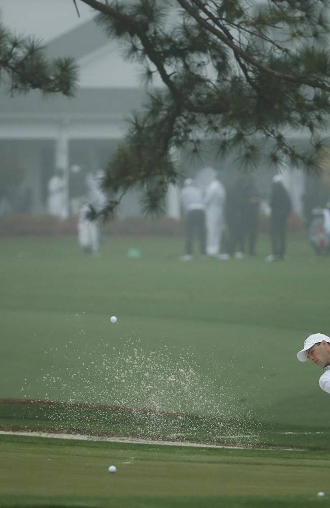 Martin Kaymer, of Germany, chips on the practice green in preparation for the Masters golf tournament Monday, April 7, 2014, in Augusta, Ga