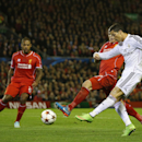 Real Madrid's Cristiano Ronaldo, right, gets in a shot during the Champions League group B soccer match between Liverpool and Real Madrid at Anfield Stadium, Liverpool, England, Wednesday Oct. 22, 2014