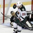 Minnesota Wild right wing Jason Pominville (29) pumps his fist after he scores against Anaheim Ducks goalie Jonas Hiller, left, of Switzerland defending in the third period of an NHL hockey game Wednesday, Dec. 11, 2013 in Anaheim, Calif. Ducks won 2-1.  (AP Photo/Alex Gallardo)