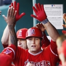 Los Angeles Angels' Chris Iannetta is congratulated after his solo home run during the fifth inning of a baseball game against the Kansas City Royals at Kauffman Stadium in Kansas City, Mo., Thursday, May 23, 2013. (AP Photo/Orlin Wagner)