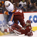 Phoenix Coyotes' Zbynek Michalek, of the right, Czech Republic, shouts as he gets his stick broken by New York Islanders' Thomas Vanek (26), of Austria, on a slash as Coyotes' Tim Kennedy (34) comes in late for the puck during the first period of an NHL h