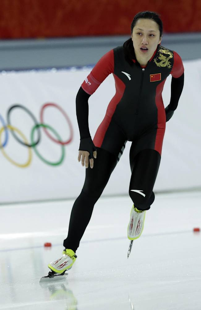China's Zang Hong celebrates after competing in the first heat of the women's 500-meter speedskating race at the Adler Arena Skating Center during the 2014 Winter Olympics, Tuesday, Feb. 11, 2014, in Sochi, Russia