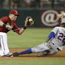 New York Mets' Eric Young Jr. (22) steals second base as Arizona Diamondbacks' Cliff Pennington, left, waits to catch the ball during the first inning of the MLB National League baseball game on Wednesday, April 16, 2014, in Phoenix The Associated Press
