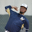 Milwaukee Brewers' Yovani Gallardo throws a pitch during baseball spring training Wednesday, Feb. 26, 2014, in Phoenix The Associated Press