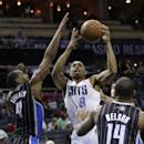 Charlotte Bobcats' Gerald Henderson (9) shoots between Orlando Magic's Arron Afflalo (4) and Jameer Nelson (14) during the first half of an NBA basketball game in Charlotte, N.C., Wednesday, Dec. 11, 2013. (AP Photo/Chuck Burton)