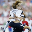 United States' Kristie Mewis (8) celebrates with teammate Lauren Cheney after scoring in the first half of an international friendly women's soccer match against South Korea in Foxborough, Mass., Saturday, June 15, 2013. (AP Photo/Michael Dwyer)
