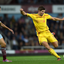 Liverpool's Steven Gerrard, right, competes for the ball with West Ham United's Stewart Downing during their English Premier League soccer match at Upton Park, London, Saturday, Sept. 20, 2014