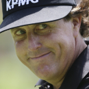 Phil Mickelson smiles his he walks to the 10th green during the third round of the PGA Championship golf tournament at Oak Hill Country Club, Saturday, Aug. 10, 2013, in Pittsford, N.Y. (AP Photo/Patrick Semansky)
