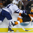 Philadelphia Flyers' Mark Streit (32), of Switzerland, is sent flying by Toronto Maple Leafs' Cody Franson (4) during the second period of an NHL hockey game, Friday, March 28, 2014, in Philadelphia The Associated Press