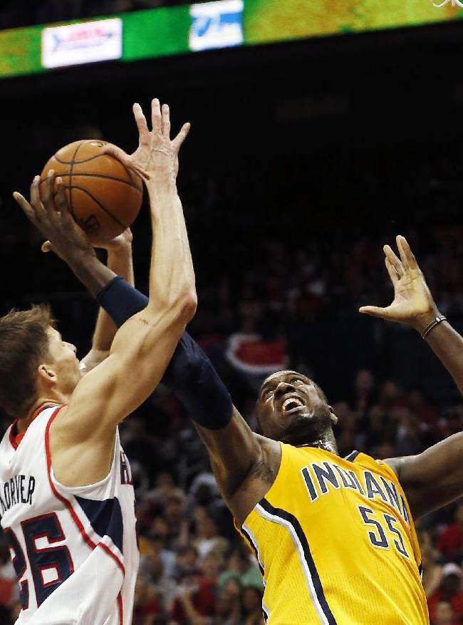 Atlanta Hawks guard Kyle Korver, left, and Indiana Pacers center Roy Hibbert (55) battle for the rebound in the first half of Game 4 of an NBA basketball first-round playoff series, Saturday, April 26, 2014, in Atlanta