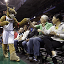 Milwaukee Bucks mascot Bango, left, high-fives fans during the first half of an NBA basketball game against the Atlanta Hawks, Wednesday, April 16, 2014, in Milwaukee. (AP Photo/Morry Gash)
