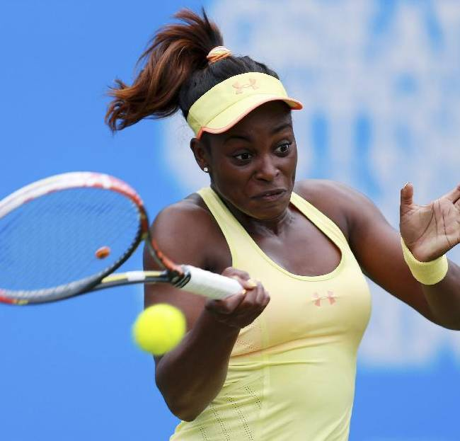 American tennis player Sloane Stephens in action against Francesca Schiavone during the AEGON Classic tennis tournament at Edgbaston Priory Club in Birmingham, England, Wednesday June 11, 2014.  Stephens, seeded 3, defeated Italian player Francesca Schiavone 6-2,6-4.  (AP Photo / David Davies, PA)