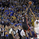 Miami Heat's LeBron James (6) shoots the game winning basket over Golden State Warriors' Andre Iguodala (9) during the second half of an NBA basketball game Wednesday, Feb. 12, 2014, in Oakland, Calif The Associated Press