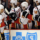 Calgary Flames defenseman Dennis Wideman (6) celebrates with teammates after scoring a goal during the second period of an NHL hockey game against the Chicago Blackhawks in Chicago, Wednesday, Oct. 15, 2014 The Associated Press