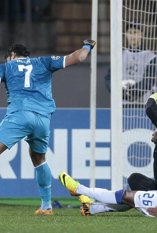 Zenit's Hulk, left, takes the ball round Porto's goalkeeper Helton, and Porto's Alex Sandro to score a goal during the Champions League group G soccer match between Zenit and Porto at Petrovsky stadium in St.Petersburg, Russia, on Wednesday, Nov. 6, 2013