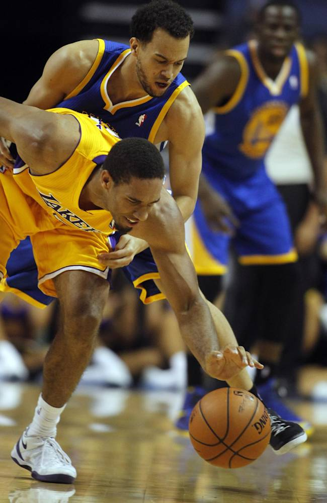 Los Angeles Lakers guard Xavier Henry, below, steals the ball from Golden State Warriors guard Cameron Jones, above, in the fourth quarter during an NBA basketball preseason game Saturday, Oct. 5, 2013, in Ontario, Calif. Lakers won the game 104-95