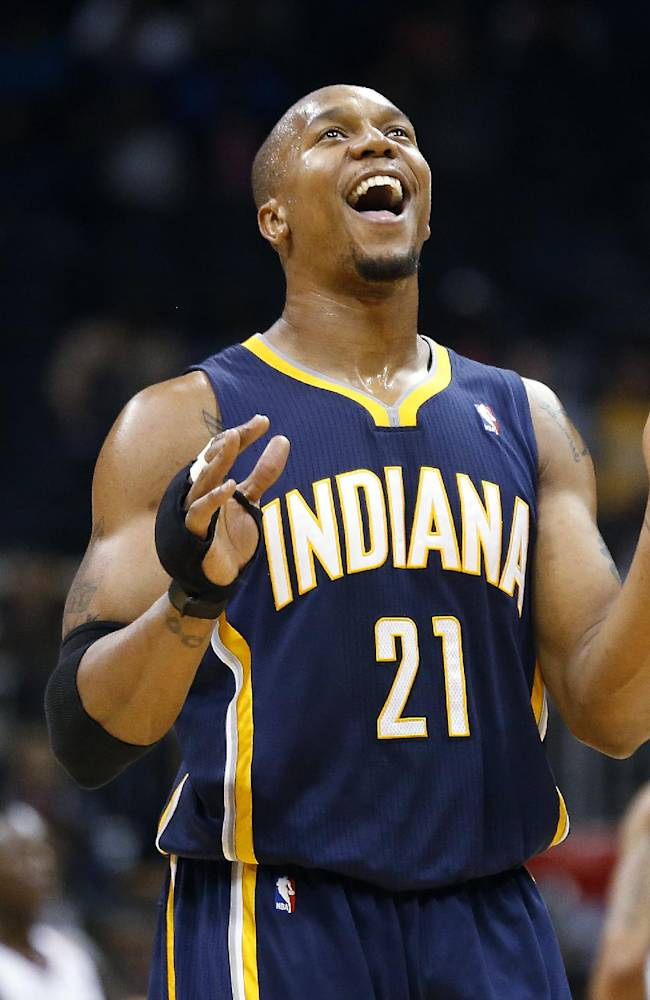 Indiana Pacers power forward David West (21) reacts late in the second half of an NBA basketball game against the Atlanta Hawks, Tuesday, Feb. 4, 2014, in Atlanta. Indiana won 89-85