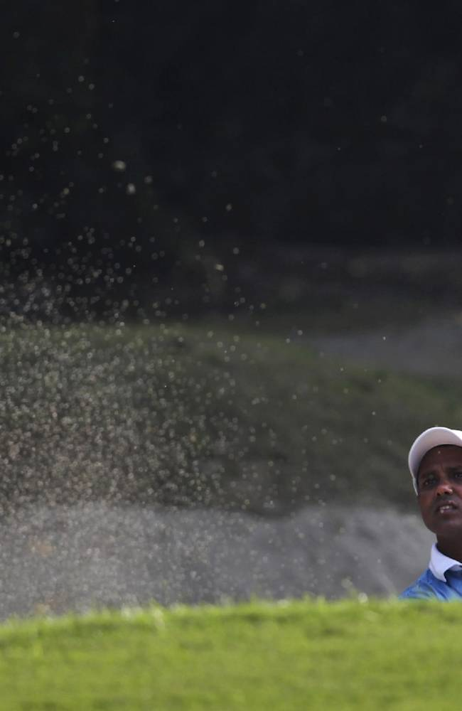 India's Shiv Chowrasia hits a ball from a bunker  the Indian Open Golf 2013 in New Delhi, India, Sunday, Nov. 10, 2013. Shiv Chowrasia finished runner-up