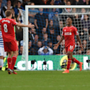 Liverpool's Raheem Sterling, right, and Steven Gerrard celebrate after Queens Park Rangers' Steven Caulker scored an own goal during their English Premier League soccer match at Loftus Road, London, Sunday, Oct. 19, 2014
