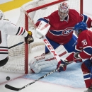Montreal Canadiens' P.K. Subban (76) defends as Chicago Blackhawks' Jonathan Toews moves in on Canadiens goaltender Carey Price during the second period of an NHL hockey game, Tuesday, Nov. 4, 2014 in Montreal The Associated Press
