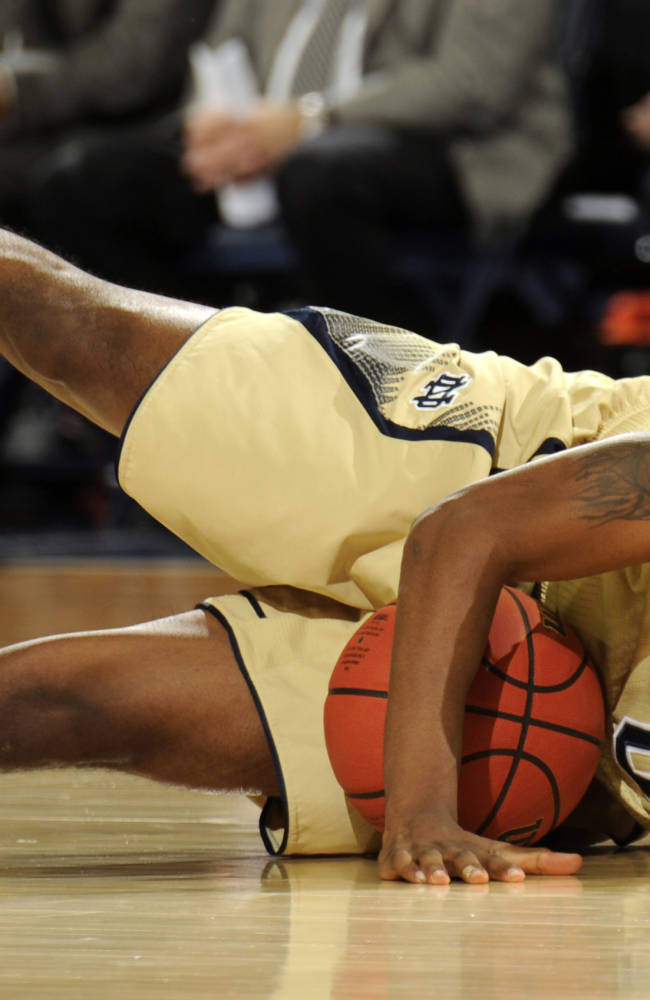 Notre Dame guard Eric Atkins grabs a loose ball during the first half of an NCAA college basketball game against Stetson, Sunday, Nov. 10, 2013, in South Bend, Ind