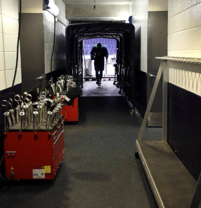 Dallas Stars' Valeri Nichushkin walks through a tunnel leading to the Stars' locker room following an NHL hockey practice Tuesday, March 11, 2014, in St. Louis. Dallas Stars' Rich Peverley is undergoing testing to determine what triggered his collapse during a game Monday night in Dallas. The Stars are scheduled to play the St. Louis Blues tonight in St. Louis