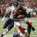 Atlanta Falcons wide receiver Julio Jones (11) fumbles the ball against Chicago Bears cornerback Kyle Fuller (23) during the first half of an NFL football game, Sunday, Oct. 12, 2014, in Atlanta The Associated Press