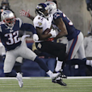 Baltimore Ravens wide receiver Torrey Smith (82) catches a pass in front of New England Patriots free safety Devin McCourty (32) and cornerback Brandon Browner, rear, in the first half of an NFL divisional playoff football game Saturday, Jan. 10, 2015, i