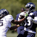 Seattle Seahawks' Richard Sherman, left, tries to pull the ball from Christine Michael at an NFL football camp practice Tuesday, July 29, 2014, in Renton, Wash The Associated Press
