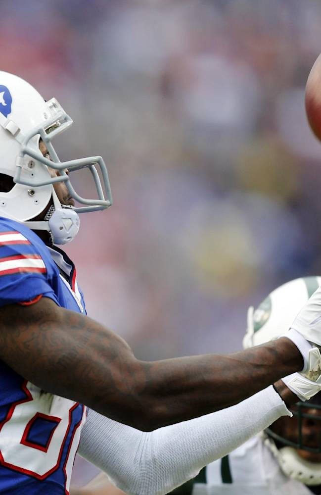 Buffalo Bills wide receiver Marquise Goodwin (88) makes a touchdown catch in front of New York Jets cornerback Antonio Cromartie during the second half of an NFL football game on Sunday, Nov. 17, 2013, in Orchard Park, N.Y