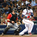 Atlanta Braves right fielder Jason Heyward, right, drives in a run with a single as Miami Marlins catcher Jarrod Saltalamacchia, left, looks on in the seventh inning of a baseball game Monday, April 21, 2014 in Atlanta The Associated Press
