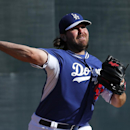 Los Angeles Dodgers pitcher Chris Perez throws during spring training baseball practice Tuesday, Feb. 11, 2014, in Glendale, Ariz The Associated Press