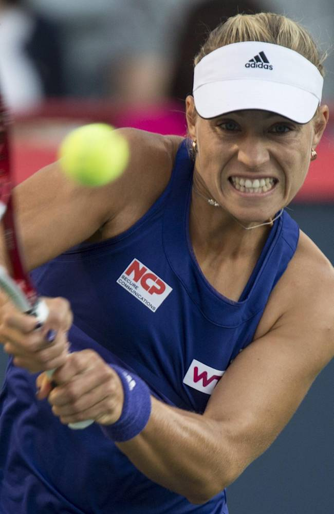Angelique Kerber, of Germany, returns to Venus Williams, of the United States, at the Rogers Cup tennis tournament, Thursday, Aug. 7, 2014, in Montreal