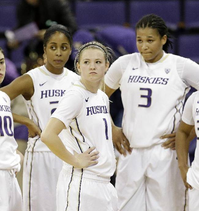Washington's Kelsey Plum (10), Aminah Williams, Mercedes Wetmore (1), Talia Walton (3) and Jazmine Davis (32) look on as officials review a last-second play against California in the second half of an NCAA women's basketball game Friday, Feb. 7, 2014, in Seattle. Cal won 70-65